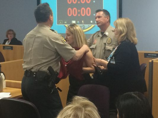 Amy Ashcroft being escorted out of AZ Medical Board